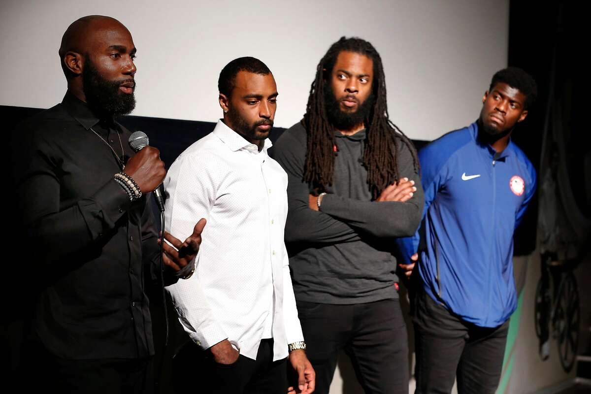 NFL players, from left, Malcolm Jenkins, Doug Baldwin, Richard Sherman and Johnson Bademosi of the Players Coalition hold a news conference before moderating a panel discussion with Alameda County district attorney candidate Pamela Price in Oakland, Calif. on Friday, May 11, 2018. Incumbent DA Nancy O'Malley was invited to attend but declined.