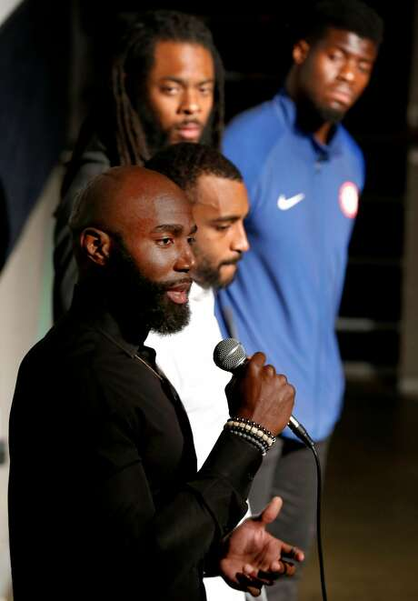 Malcolm Jenkins (front), Doug Baldwin, Richard Sherman and Johnson Bademosi of the NFL Players Coalition hold a news conference before moderating a panel discussion with Alameda County district attorney candidate Pamela Price in Oakland. Photo: Paul Chinn / The Chronicle