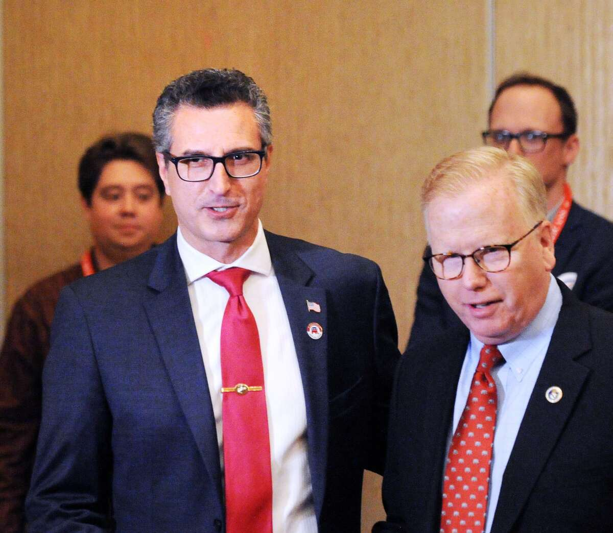 Candidate Manny Santos, left, the former Mayor of Meriden, during the nominating process for the Republican candidate for the 5th District Congressional seat at the Republican State Convention at Foxwoods Casino, Mashantucket, Conn., Friday, May 11, 2018. At right is Danbury Mayor Mark Boughton.