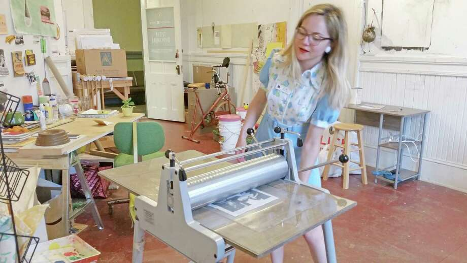 Launchpad Program artist and printmaker Amy Ozga, 23, of Bristol demonstrates how her printing press works at her studio space above Five Points Gallery. For the full story see page B1. Photo: NF Ambery