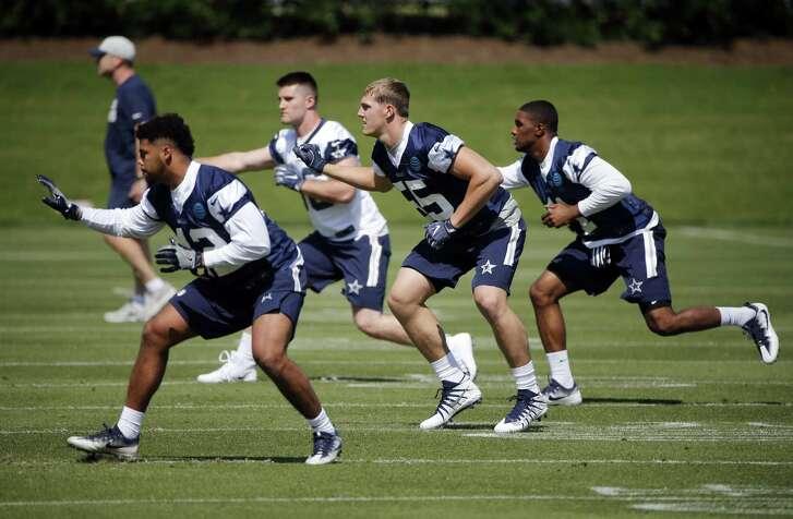 Dallas Cowboys inebacker Ed Shockley (42), tight end Dalton Shultz (86), Leighton Vander Esch (55) and linebacker Kyle Queiro (41) go through drills during the team's NFL football rookie minicamp in Frisco, Texas on Friday, May 11, 2018 (AP Photo/Michael Ainsworth)