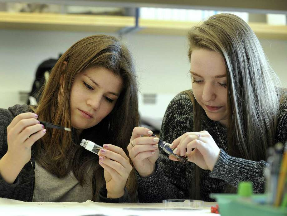 Sandra Zapata-Ramirez, 25, left, and Brittany Schappach, 23, are biology majors at Western Connecticut State University. More women are becoming scientists but more can be done to help them succeed. Photo: Carol Kaliff /Hearst Connecticut Media / The News-Times