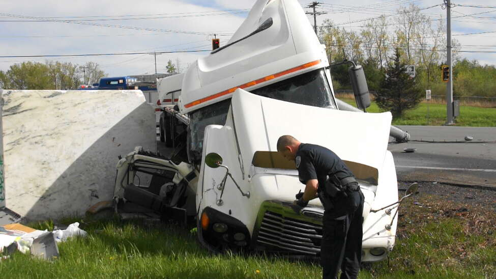 Police investigate the scene of a crash Friday afternoon at the intersection of Route 9 and 20. Injuries were reported. (Martin Miller / Special to the Times Union)