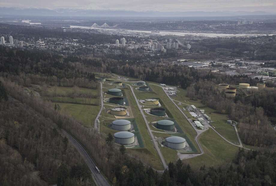 An aerial view shows the Kinder Morgan Inc. oil storage facility in Burnaby, where oil arrives from the Trans Mountain pipeline. An expansion proposal would triple pipeline capacity. Photo: Jonathan Hayward / Canadian Press 2016