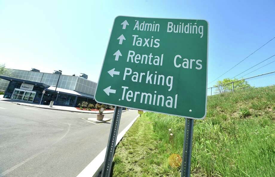 A sign directs travelers at Tweed New Haven Regional Airport on May 8, 2018. Photo: Arnold Gold / Hearst Connecticut Media / New Haven Register