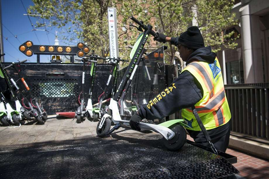 A couple rental scooters found their way to a Recology transfer station, one step before the dump. Wonder how they got there? Photo: David Paul Morris / Bloomberg