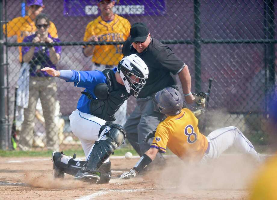 Westhill's Alex Cordone (8) scores in the second inning as Darien catcher Arthur Xanthos (5) loses the ball during an FCIAC boys baseball game at Westhill High School on May 11, 2018 in Stamford, Connecticut. Westhill defeated Darien 4-3. Photo: Matthew Brown, Hearst Connecticut Media / Stamford Advocate