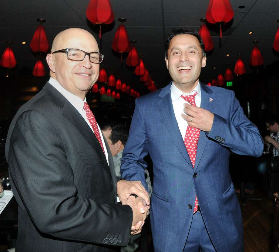 Greenwich resident Harry Arora, right, celebrates his nomination as the Republican candidate for the 4th Congressional District seat with his campaign manager Jan Rogers Kniffen in the Red Lantern Restaurant during the Republican State Convention at Foxwoods Casino, Mashantucket, Conn., Friday, May 11, 2018. Photo: Bob Luckey Jr. / Hearst Connecticut Media / Greenwich Time