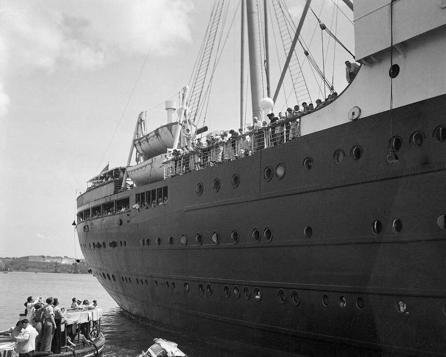 In this file photo of June 1, 1939, the German liner St. Louis is denied entrance to the Havana, Cuba harbor. The ship, carrying 917 German Jewish refugees, was later denied entrance to the United States and returned to Hamburg, Germany. A new book disputes widely held assumptions that President Franklin D. Roosevelt was insensitive to the plight of European Jews under the Nazis, and instead concludes that he tried to arrange resettlement for thousands of refugees in the late 1930s, only to be thwarted by his own State Department. Photo: AP / AP