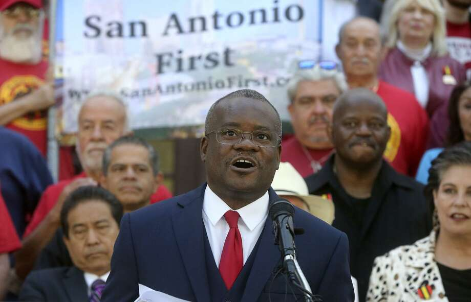 Chris Steele, center, president of the San Antonio Professional Firefighters Association, speaks on the steps of City Hall in April about the union's petition campaign to call for an election in November that could change the city's charter. Photo: John Davenport /San Antonio Express-News / ©John Davenport/San Antonio Express-News