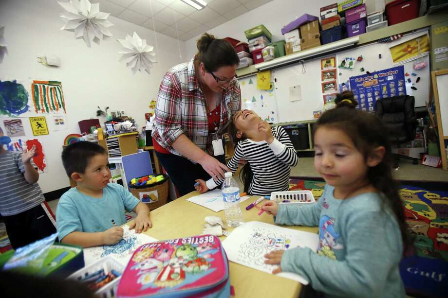 In this Thursday, Dec. 7, 2017,  photo, Natasha Juarez, a preschool teaching assistant at Turquoise Trail Charter School in Santa Fe, N.M., helps Kaia Ortiz, 4. An analysis of public school funding in New Mexico shows federal financial support is on the rise without necessarily boosting student academic performance. (Luis Sanchez Saturno/Santa Fe New Mexican via AP) Photo: Luis Sanchez Saturno, MBO / Associated Press / Santa Fe New Mexican