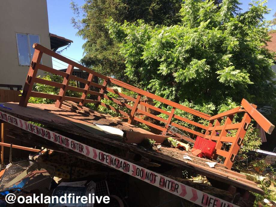 Two people were taken to a trauma center for injuries sustained when a patio collapsed in Oakland, officials said. Photo: Oakland Fire Department