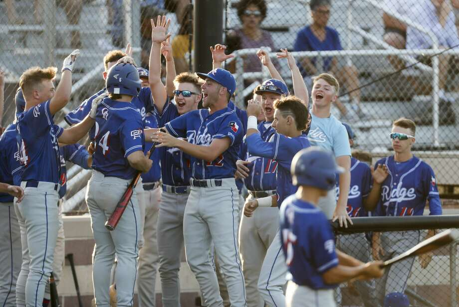Oak Ridge right fielder Chase Roberts (24) celebrates scoring off an RBI single by James Starnes off Dallas Jesuit  starter Tyler Murrah during the fifth inning of Game 1 of the Class 6A Region II area playoff series on Thursday, May 10, 2018, in Dallas. Oak Ridge took game one with a 3-1 win. ( Brett Coomer / Houston Chronicle ) Photo: Brett Coomer/Houston Chronicle