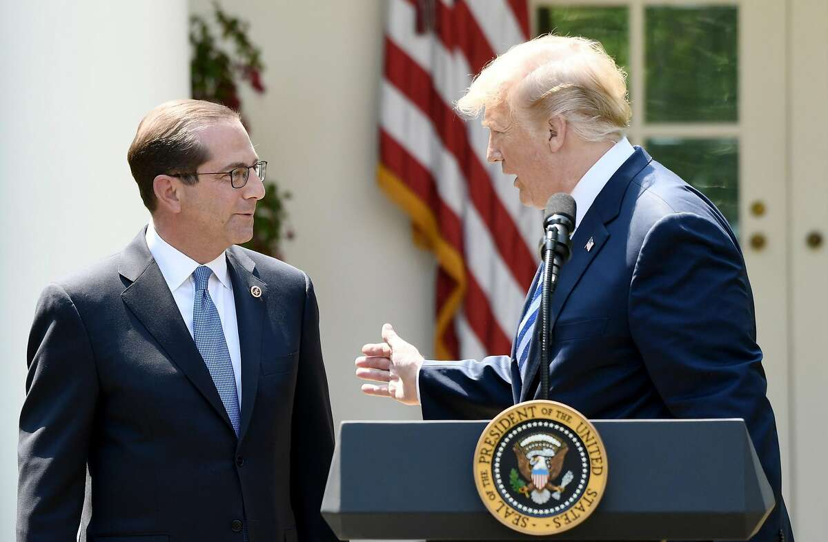 U.S. President Donald Trump speaks about lowering drug prices as Secretary of Health and Human Services Alex Azar listens during an event in the Rose Garden of the White House May 11, 2018 in Washington, D.C. (Olivier Douliery/Abaca Press/TNS)