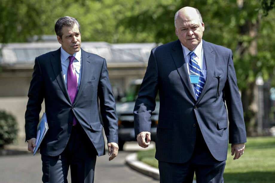Jim Hackett, president and chief executive officer of Ford Motor Co., right, and John Bozzella, president and chief executive officer of Association of Global Automakers Inc., arrive for a meeting with U.S. President Donald Trump, not pictured, at the White House in Washington, D.C., U.S., on Friday, May 11, 2018. Automaker executives plan to emphasize their support for easing the Obama-era standards, but not so much that it triggers a conflict with California and results in a split market of environmental regulations set by Washington and Sacramento. Photographer: Andrew Harrer/Bloomberg Photo: Andrew Harrer / © 2018 Bloomberg Finance LP