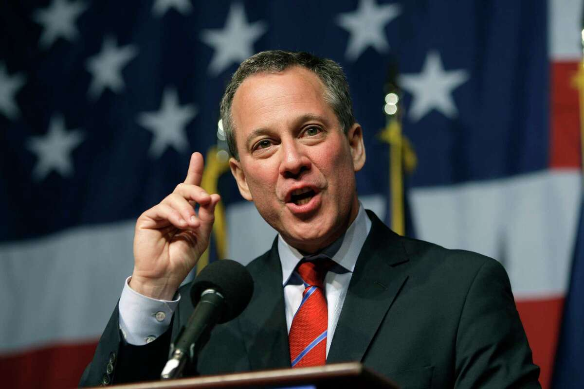 FILE - In this Nov. 3, 2010 file photo, New York Attorney General-elect Eric Schneiderman gestures while giving his victory speech just past midnight in New York. A New York lawyer said he told President Donald Trump's attorney, Michael Cohen, years ago that Schneiderman was abusing women. Schneiderman, a frequent legal nemesis of the president, resigned this week after The New Yorker published the accounts of four women who said they were slapped and choked by the Democrat. (AP Photo/Frank Franklin II, File)