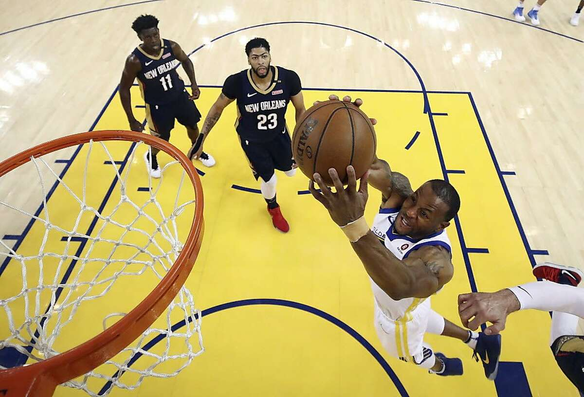 Golden State Warriors' Andre Iguodala, bottom right, goes up for a shot against the New Orleans Pelicans during the first half in Game 5 of an NBA basketball second-round playoff series Tuesday, May 8, 2018, in Oakland, Calif. (Ezra Shaw/Pool Photo via AP)
