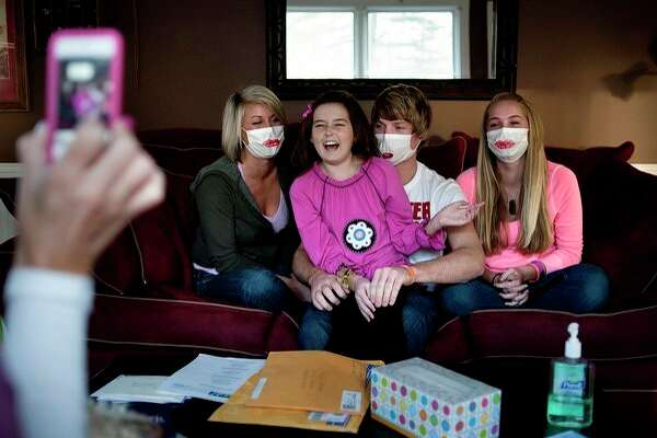 In this Daily News file photo, Mary Juengel (second from left), then a sixth-grader at Jefferson Middle School, laughs with her siblings (from left) Clara, Steven, and Ellie as her mother, Marni, records a video update for the 'Team Mary' Facebook group in 2011.