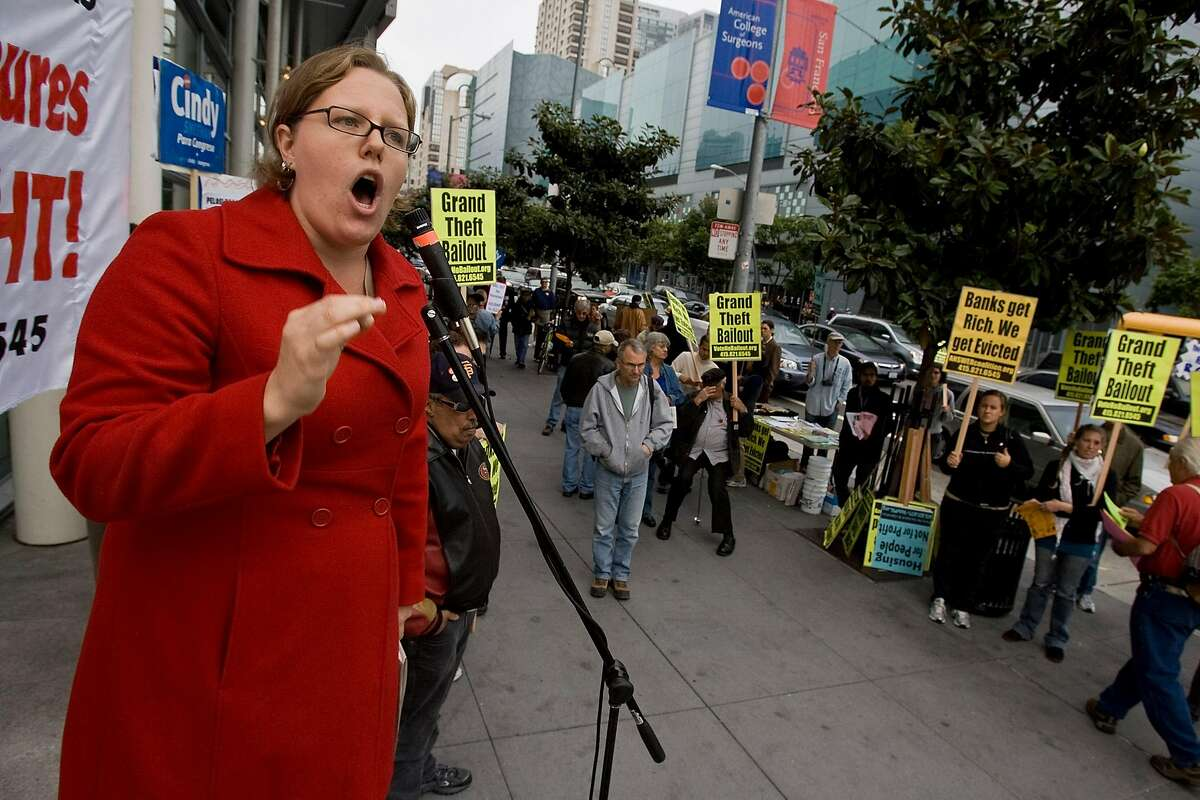 Nathalie Hrizi speaks to protesters as they gather in front of the Moscone Center to protest the beginning of the Mortgage Bankers National Conference on October 18, 2008 in San Francisco, California. (Photograph by David Paul Morris / The Chronicle)