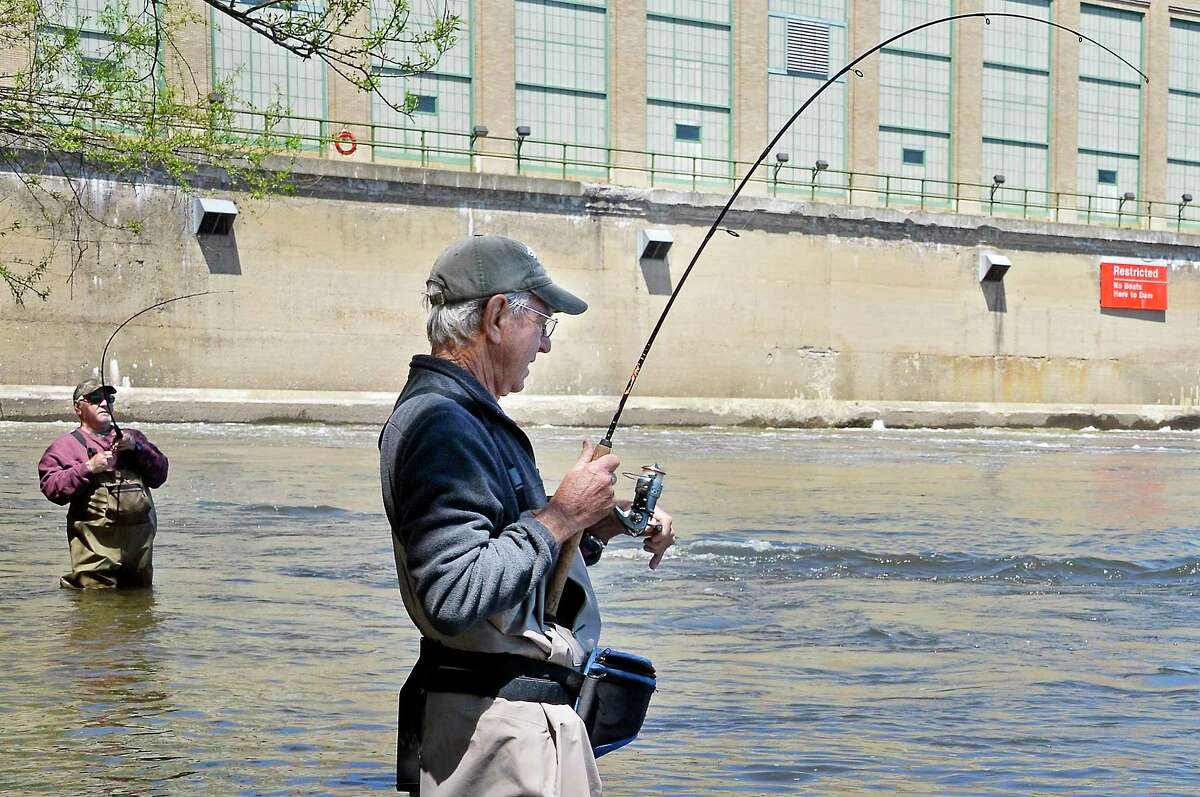 Striper fishermen Roger Zalucky, left, of Troy, and Jack Whitman of Colonie both hook into fish while wading the Hudson River Friday May 11, 2018 in Green Island, NY. (John Carl D'Annibale/Times Union)