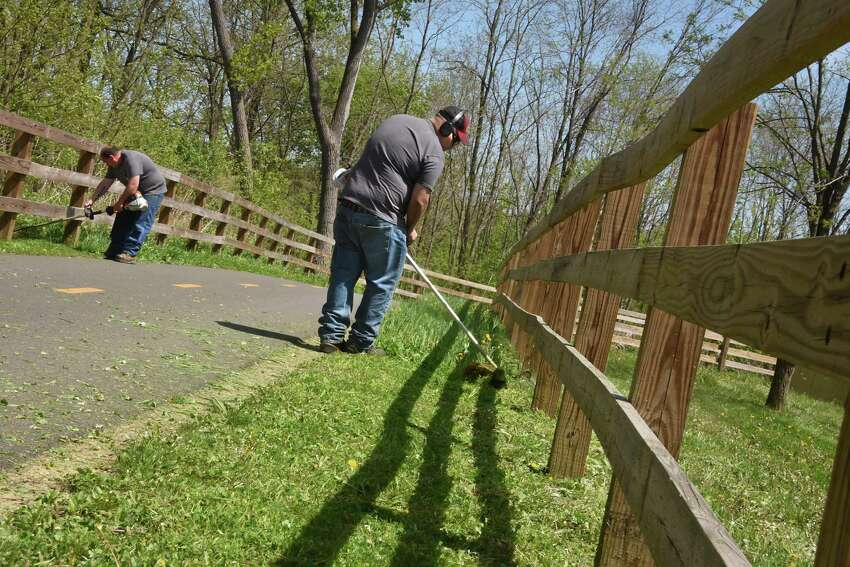 Albany County Department of Public Works employees Eric Fortune, left, and Sean Peck use weed wackers to trim the grass along the Albany County Helderberg Hudson Rail Trail on Friday, May 11, 2018 in Albany, N.Y. (Lori Van Buren/Times Union)