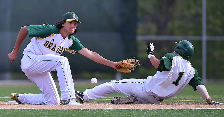Notre Dame-West Haven sophomore Maxwell Mariano steals second on Hamden freshman shortstop Jake Pisano, Friday, May 11, 2018, at Hamden High School. Notre Dame won, 11-5. Photo: Catherine Avalone, Hearst Connecticut Media / New Haven Register