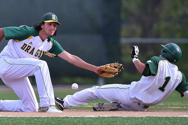Notre Dame-West Haven sophomore Maxwell Mariano steals second on Hamden freshman shortstop Jake Pisano, Friday, May 11, 2018, at Hamden High School. Notre Dame won, 11-5.