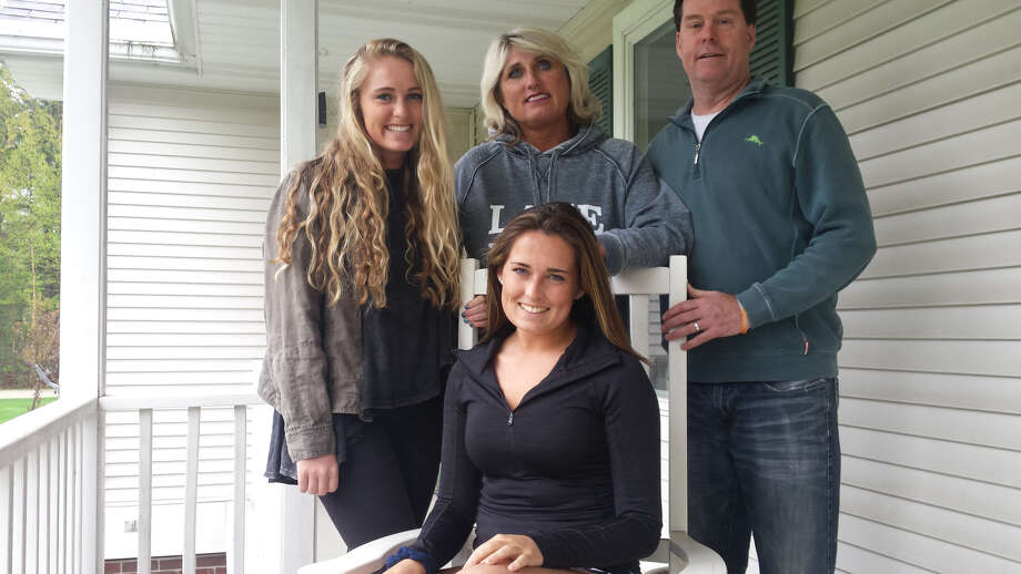 Mary Juengel (front), now an 18-year-old junior at Dow High, poses on the front porch of the family home in Midland with (from left) sister Ellie, mother Marni, and father Mark. (Fred Kelly/fred.kelly@mdn.net) Photo: Fred Kelly, Fred.kelly@mdn.net