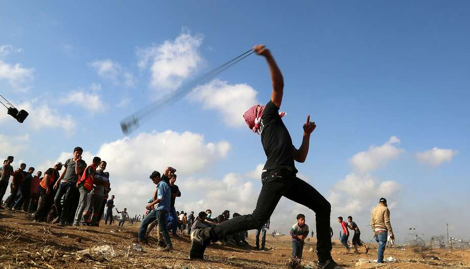 Palestinian demonstrators during clashes with Israeli forces east of Gaza City last week. Photo: NurPhoto / TNS