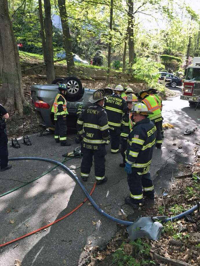 One person was extricated from a car flipped on its roof in Monroe, Conn., on May 11, 2018. Photo: Contributed Photo / Monroe Volunteer Fire Department / Contributed Photo / Connecticut Post Contributed