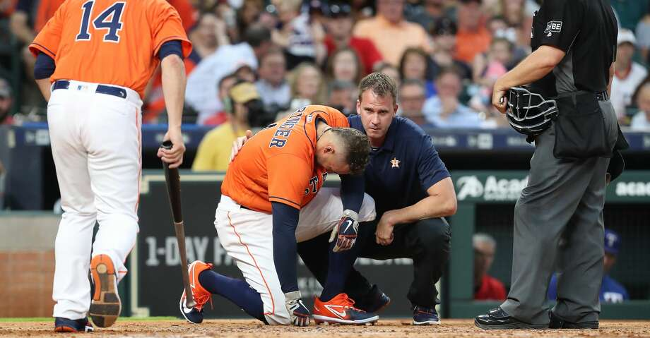 Houston Astros center fielder George Springer (4) reacts after being hit by a Texas Rangers starting pitcher Cole Hamels (35) pitch in the 3rd inning at Minute Maid Park Friday, May 11, 2018, in Houston. ( Steve Gonzales / Houston Chronicle ) Photo: Steve Gonzales/Houston Chronicle
