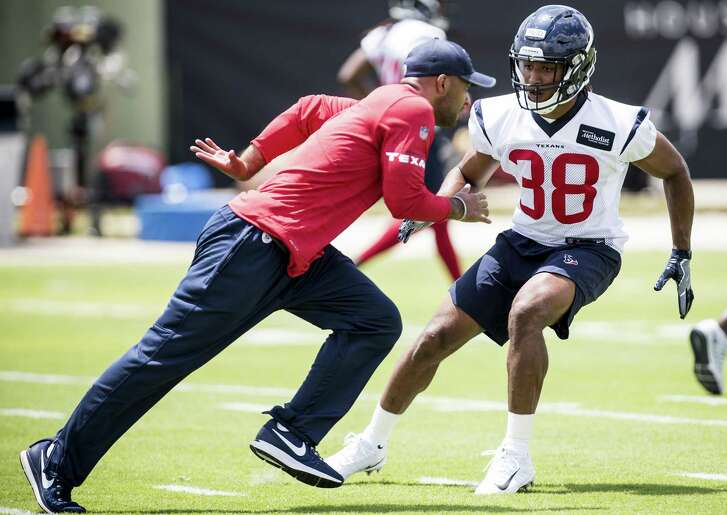 Texans assistant secondary coach D'Anton Lynn, left, works with safety Justin Reid during the rookie's first NFL practice.