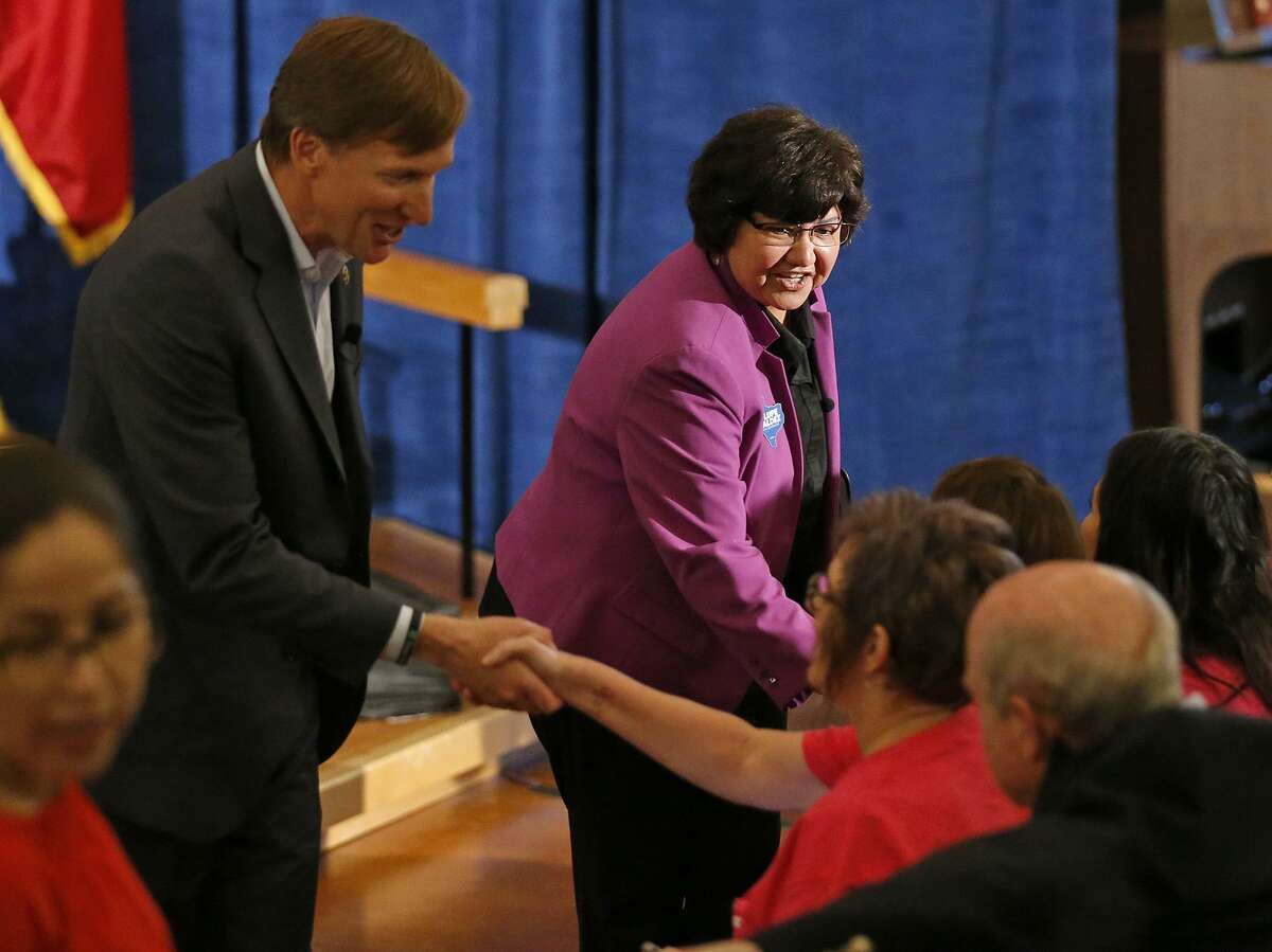 Texas Democratic Gubernatorial candidates Andrew White (left) and Lupe Valdez shake hands with audience members after their debate Friday May 11, 2018 at St. James Episcopal Church in Austin.