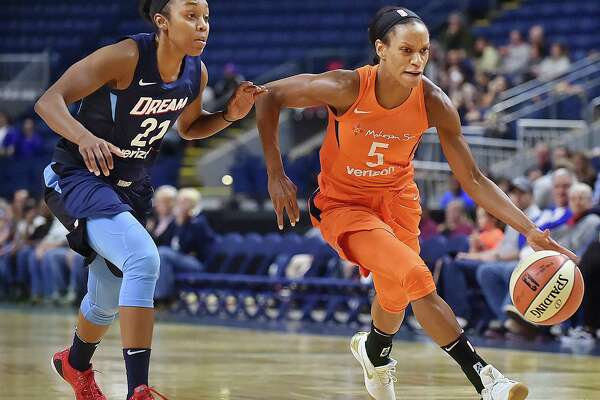 Connecticut Sun guard Jasmine Thomas drives past Atlanta Dream's and UCONN guard Renee Montgomery,  74-58, Friday, May 11, 2018, at the Webster Bank Arena in Bridgeport.