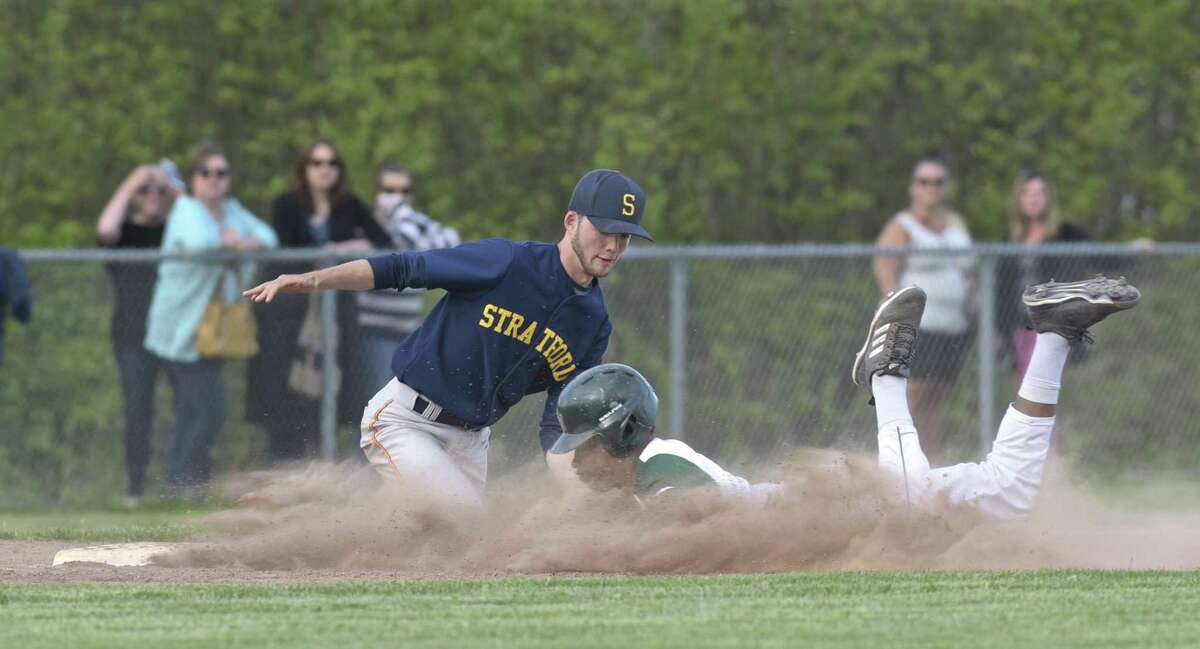 New Milford's Kendall Green (7) slides safely into third as Stratford's Brendan Duffy (1) tries for the tag in the boys baseball game between Stratford and New Milford high schools, Friday afternoon, May 11, 2018, at New Milford High School, New Milford, Conn.