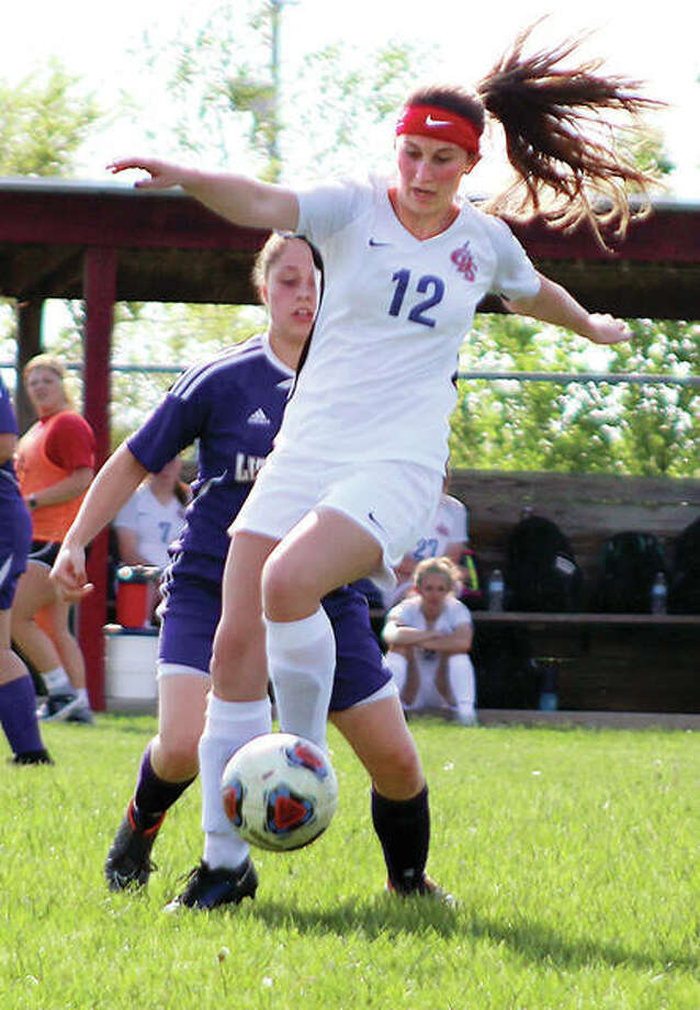 Carlinville's Taylor Wills (12) settles the ball in front of Litchfield's Maddie Diamond in Carlinville's 4-0 victory in the championship of its own Class 1A regional at Loveless Park. Photo:       Pete Hayes | The Telegraph