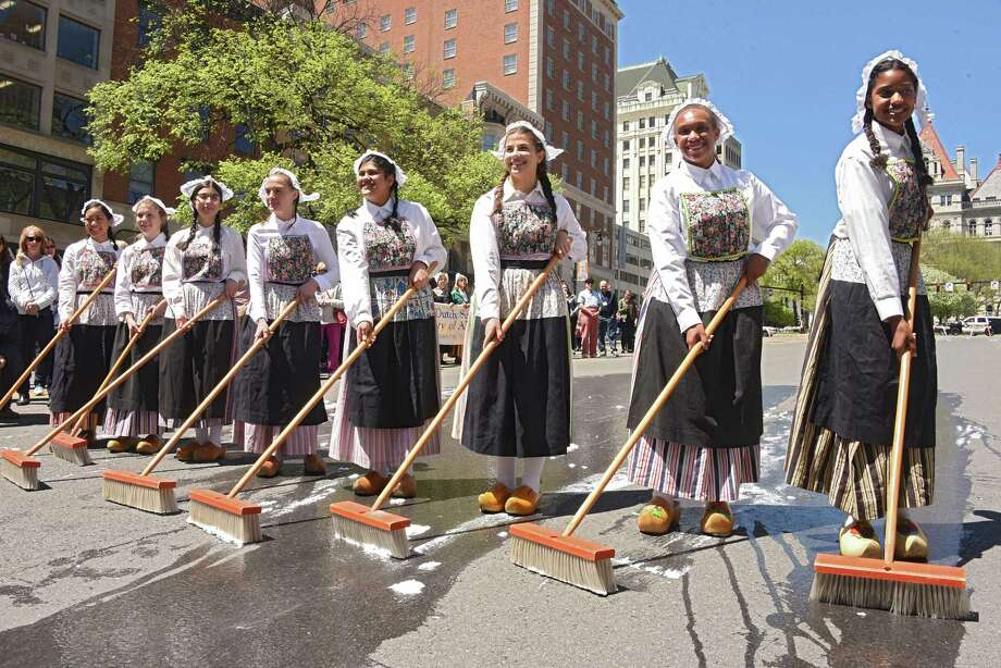 Albany High School seniors, from left, Gail Cabahug, Juliette Geraghty, Laura Marin, Abigail Scheuermann, Ashma Thapa, Erin Lippitt, Sarha Smith-Moyo and Calena Rodriguez participate during the traditional street scrubbing event to kick off the 70th Annual Tulip Festival on Friday, May 11, 2018 in Albany, N.Y. (Lori Van Buren/Times Union) Photo: Lori Van Buren / 20043719A