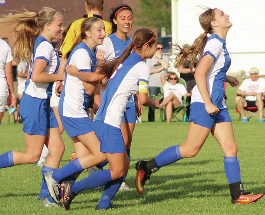 Roxana's (from left) Olivia Mouser, Macie Lucas, Brynn Huddleston, Mykayla Rosales and Abby Kurth celebrate Lucas' goal that tied the match 2-2 with 6:31 left in regulation Friday in the title match of the Breese Central Class 1A Regional. Lucas added a goal in overtime to give the Shells a 3-2 victory over Wesclin. Photo:       Greg Shashack / The Telegraph