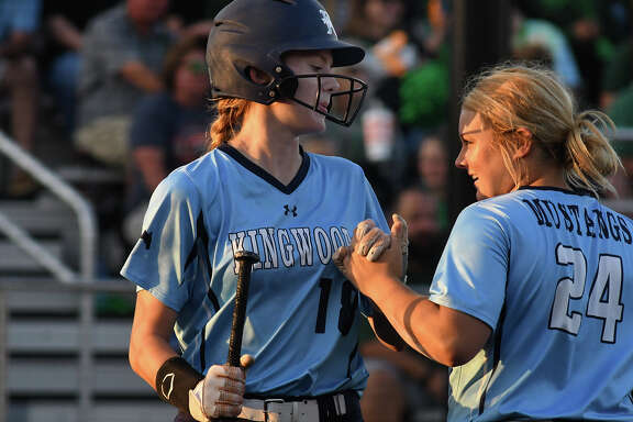 Kingwood centerfielder Ashley York, left, is greeted by teammate Maddie Lindsey after York scored against Clear Falls in the bottom of the first inning of their Region III-6A Quarterfinal Softball Playoff at Crosby High School on May 11, 2018. (Jerry Baker/For the Chronicle)