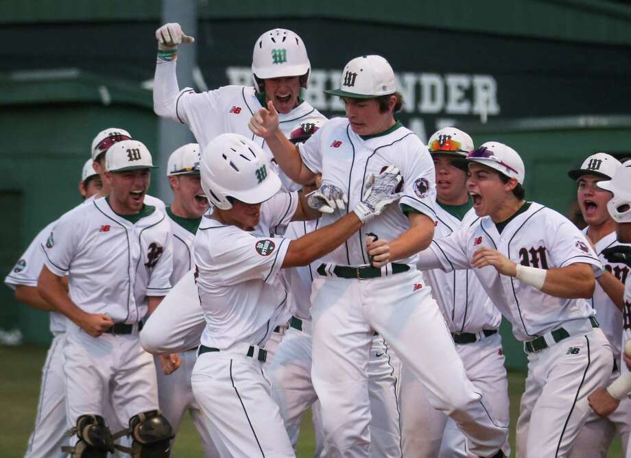 The Woodlands' PJ Villarreal (27) celebrates with teammates after bringing home two runs during the baseball game against Sachse on Friday, May 11, 2018, at Scotland Yards. (Michael Minasi / Houston Chronicle) Photo: Michael Minasi, Staff Photographer / © 2018 Houston Chronicle