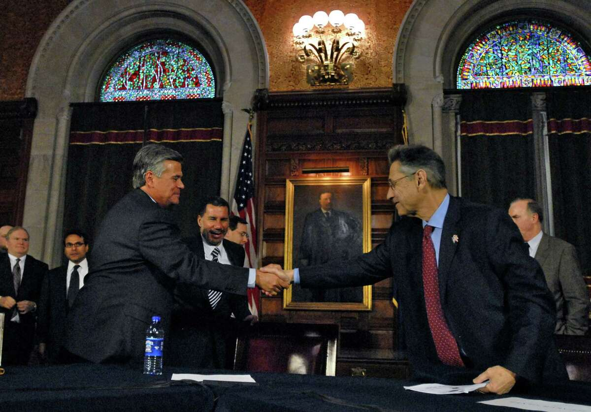PHILIP KAMRASS/TIMES UNION -- Senate Majority Leader Dean Skelos, left, shakes hands with Assembly Speaker Sheldon Silver, right, while Governor David Paterson stands behind them at the conclusion of a legislative leaders meeting to discuss the state's fiscal crisis, in the Capitol in Albany, NY Tuesday November 18, 2008.