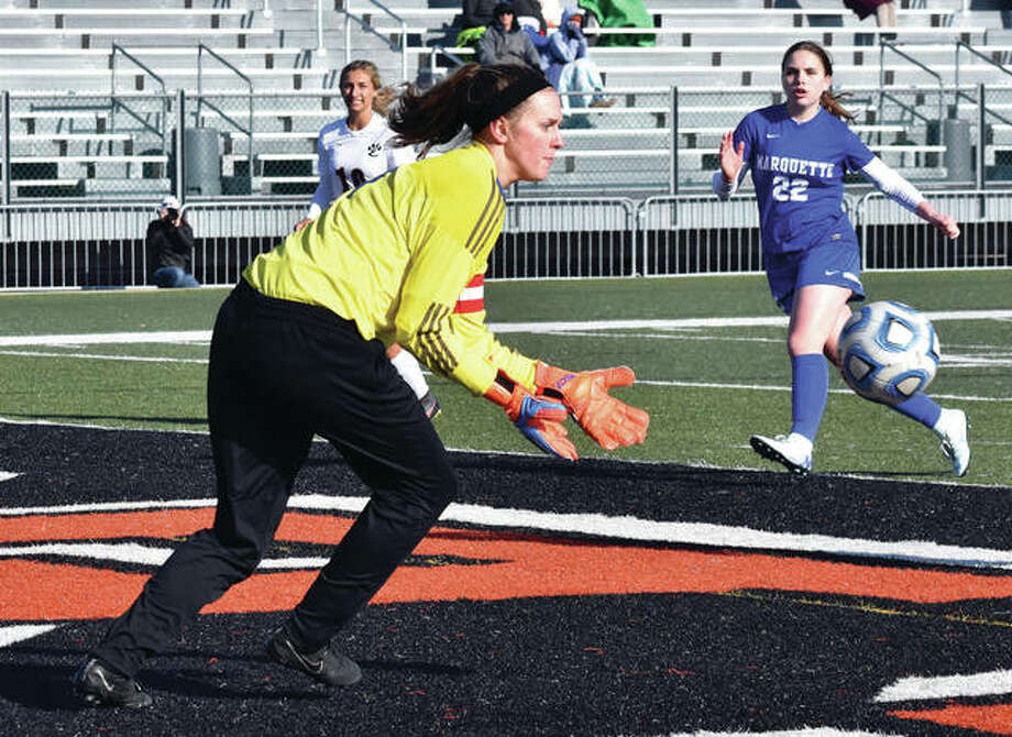 Marquette Catholic goalie Lauren Fischer makes a save during a game earlier this season at Edwardsville. Fischer and the Explorers won another Class 1A regional title Friday by beating Breese Mater Dei at Moore Park in Alton. Photo:     Matthew Kamp / Hearst Newspapers