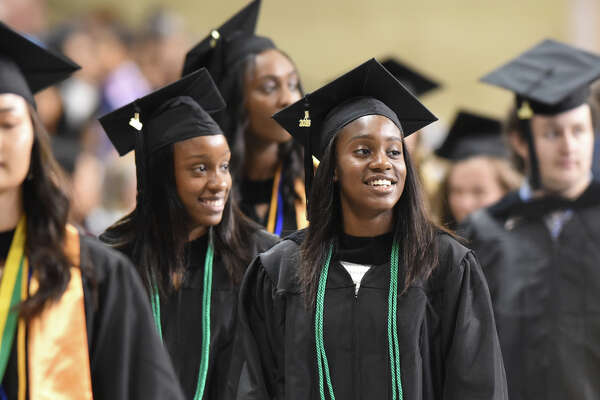 Alexandrea Washington and Alexis Washington prepare to receive their diplomas during the Midland College commencement ceremony May 11, 2018, at Chaparral Center. James Durbin/Reporter-Telegram