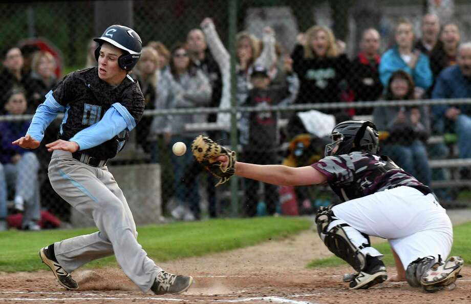 Columbia's Justin Pangburn ,left, is safe as Colonie catcher Jake Hutton drops the ball during a Section II high school baseball game Friday, May 11, 2018, in Colonie, N.Y. (Hans Pennink / Special to the Times Union) Photo: Hans Pennink / Hans Pennink