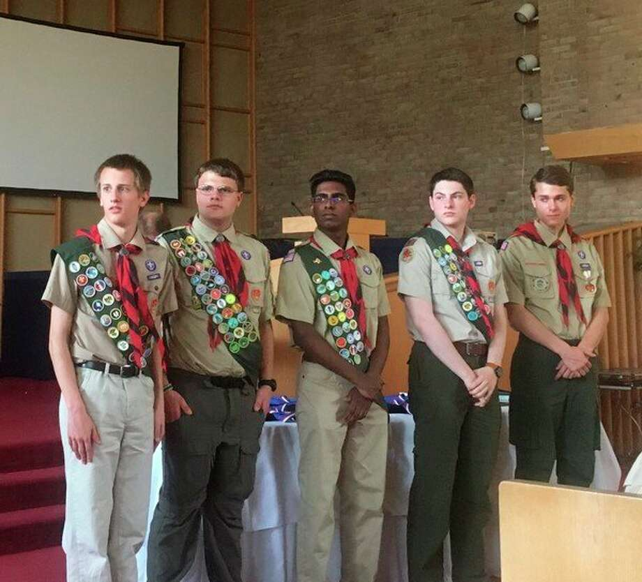 From left, Kenny Steinhilber, Jacob Miller, Nihal Manjila, Jack Light, and Justin Witt are honored at the Eagle Scout Court of Honor on May 5.