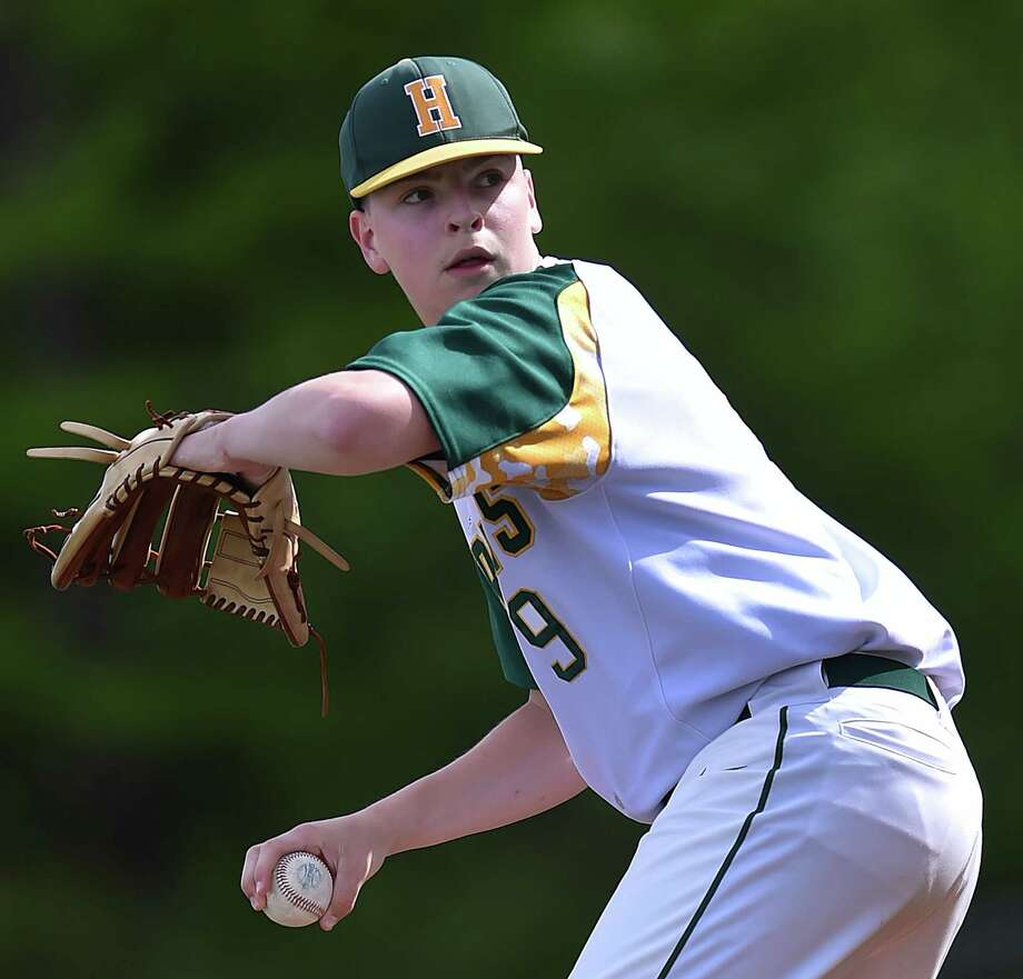 Hamden's Jake Michaud delivers a pitch against Notre Dame-West Haven, Friday, May 11, 2018, at Hamden High School. The Green Knights won, 11-5. Photo: Catherine Avalone, Hearst Connecticut Media / New Haven Register
