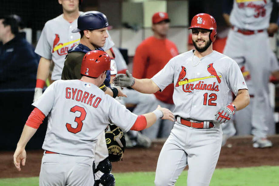 The Cardinals' Paul DeJong (right) is greeted by teammate Jedd Gyorko after DeJong's three-run home run during the second inning against the Padres on Friday night in San Diego. Photo:       Associated Press