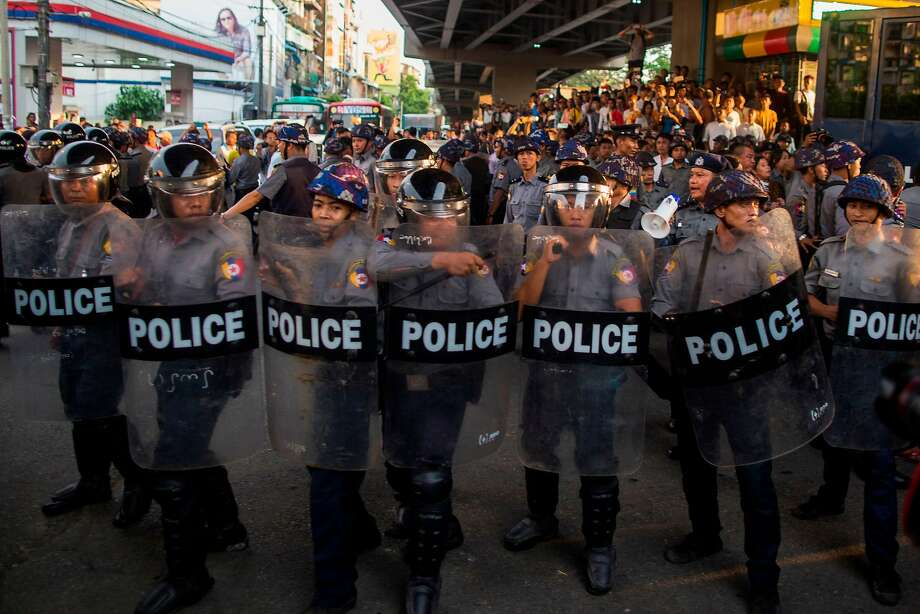 Police advance toward demonstrators during a war protest in Yangon. Protesters were calling for an end to the violence in Kachin State and elsewhere in the country. Eight were arrested. Photo: Sai Aung Main / AFP / Getty Images