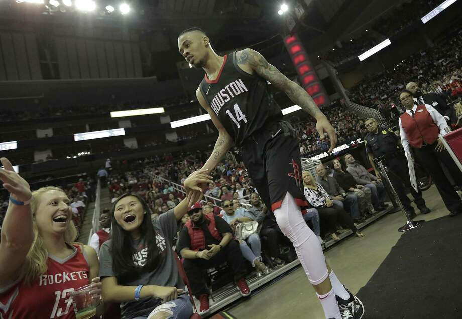 Houston Rockets guard Gerald Green (14) slaps hands with fans after being fouled in the second half of game action against the Chicago Bulls at the Toyota Center on Tuesday, March 27, 2018, in Houston. Rockets won the game 118-86. ( Elizabeth Conley / Houston Chronicle ) Photo: Elizabeth Conley, Chronicle / Houston Chronicle / © 2018 Houston Chronicle