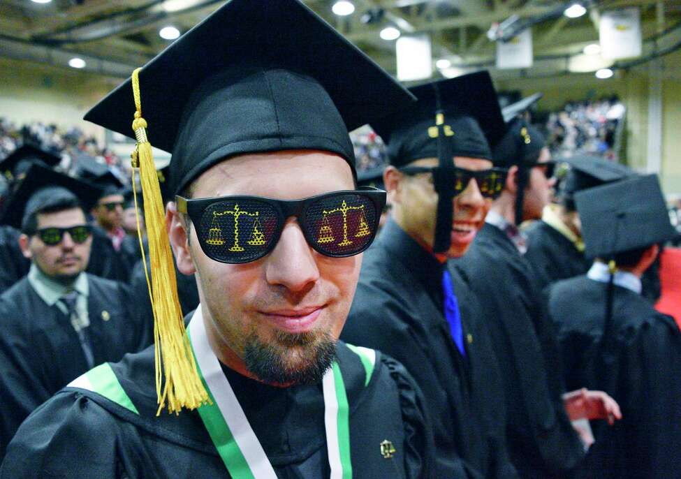 Enrollment at SUNY community colleges fell 23 percent between 2010 and 2019. Click through the slideshow to see the decline. The schools with the smallest decreases appear first. Source: SUNY Analysis: Times Union Hudson Valley Community College criminal justice graduate Brandon Ambrosino of Fonda sports a pair of Scales of Justice shades during Commencement Saturday May 12, 2018 in Troy, NY. (John Carl D'Annibale/Times Union)